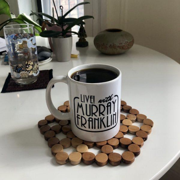 Live with Murray Franklin joker mug